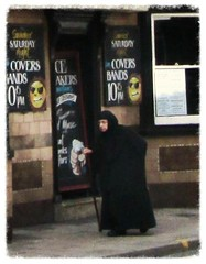 Old lady in black (JNP2014) Tags: cane advertising hijab walkingstick oldwoman niqab traditionalcostume arabwoman
