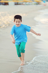 (lexandra) Tags: boy sea summer beach wet water happy kid sand child waterfront dynamic running clothes coastline gettyimages