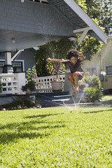 bxp256063 (c21prolink) Tags: boy summer house playing water smile grass childhood smiling fun freedom kid day exterior child frolic outdoor merriment cottage lawn fulllength free running sprinkler africanamerican midair copyspace brunette joyful swimsuit frontyard refreshing playful enjoying carefree enjoyment irrigation bungalow spraying lookingaway watering lively gaiety homelife exuberant splashing frolicking armsoutstretched onepersononly 79years boisterous 24744793 c21prolink century21prolink
