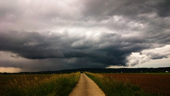 First Summerstorm (Aristokrat_) Tags: summer black field forest germany moody sony south rainstorm thunderstorm feeling z1 gewitter schwarzwald compact intimidating xperia cloudsstormssunsetssunrises
