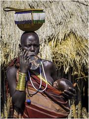 Mursi Tribe Woman and Child (Luc V. de Zeeuw) Tags: child clay corn ethiopia lipplates mun mursi omo omovalley plate tribe woman wood southernnationsnationalitiesandpeoplesregion