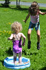 Jumpy Fun (Vegan Butterfly) Tags: children kids people child kid play playing together friends friendship summer outside outdoor fun pool grass jump jumping