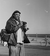Photographer on the Boardwalk (Dalliance with Light (Andy Farmer)) Tags: mediumformat beach hp5 photographer rolleiflex boardwalk asburypark nj iso800 diafine ocean bw street film shore