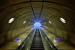 Photon Accelerator (Douguerreotype) Tags: london uk underground urban british architecture city tunnel britain subway tube gb metro england blue escalator symmetry