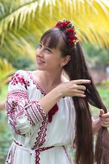 Hair (Pavlo Kuzyk) Tags: girl dress embroidered wreath palm tree nature canon malaysia
