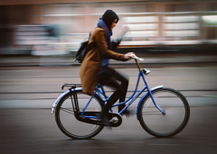 Blue Brown Blitz (Rolling Spoke) Tags: bike bici bicycle bicicleta bicicletta bisiklet ciclismo fiets velo street streetphotography blur pan panned panning motion ride cycle cycling girl rain weather outdoors speed amsterdam