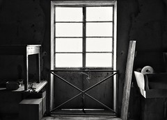 Light! (henryark) Tags: indoor blackandwhite abstract monochrome monochromatic door light wood iron steel raw rusty old vintage factory workshop composition proportions black dark naturallight table shelf railing string coil web dirty boxes paper cartonbox tuscany italy enrico nannini henryark nikon nikond750 fullframe gloomy atmosphere