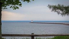 Lighthouse In The Distance (J&E Adventures) Tags: lighthouse coastline landscape uppermichigan lakesuperior exploring iphone phonephotography up michigancoast puremichigan upperpeninsula michigan