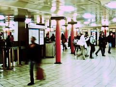 PICCADILLY CIRCUS 5 (Nigel Bewley) Tags: city uk longexposure england urban london station underground blurry candid transport tube grain piccadillycircus commuter tubestation londonunderground rushhour grainy publictransport thetube mindthegap commuters piccadillyline londontransport tfl pointillism tubetrain transportforlondon bakerlooline pointillist alternativedigital ticketconcourse