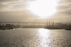 Sun (filipe.gcoelho) Tags: bridge sunset sun sol portugal rio river de boats do barcos lisboa lisbon abril ponte 25 pr