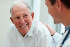 Happy old man having a casual talk with a doctor (Netlivre) Tags: new old portrait people man male men senior smile smiling hospital denmark happy person idea support adult background joy grandfather young talk fresh patient medical help health human doctor elderly frame friendly older conversation aged concept caring care cheerful talking retired citizen issues helpful speaking retirement consulting weak comforting pensioner orthopedic manbackgroundpeopleoldnewhappyyoungmenmaleframesmiles