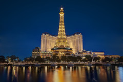 A Place Like Paris... (JH Images.co.uk) Tags: sky usa gambling paris colour reflection water yellow night french lights hotel lasvegas nevada eiffeltower casino symmetry symmetric bluehour ballys dri hdr
