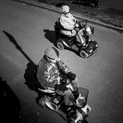 Beach Race - The Finish Line (shotbywiles) Tags: street old beach race pier streetphotography somerset scooter elderly esplanade fujifilm seafront finishline mobility clevedon oap streetphotographer oldperson beachrace mobilityvehicle xpro1 xmount xf18mm wilesphotographer wwwwilesphotographycom wilesphotography wilesukstreetphotography wilesukstreetphotographer