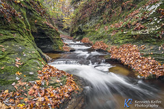 Autumn at the Potholes (Kenneth Keifer) Tags: colors creek fallcreek fallcreekgorge foliage indiana leaves moss october stream thepotholes warrencounty waterfall autumn blurred brook canyon cascade cascading cataract chasm cliff colorful erosion flowing gorge longexposure midwest nature potholes preserve ravine rock rural sandstone scenic splash splashing stone swirls tiered tiers whitewater