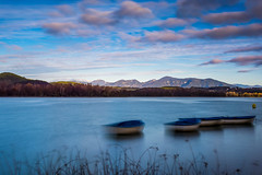 A lEstany (vilchesdavid) Tags: estany banyoles pladelestany nikon sigma30 longexposure largaexposicin barca water autumn clouds blue mountains d7100 landscape morning maana filtro nd ndfilter
