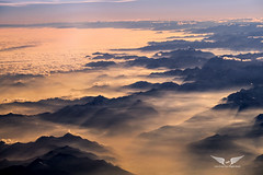 Sunset over the Alps (gc232) Tags: alps sunset sunrise altitude live from flight deck flying over mountains europe sun light shadows shadow clouds cloud fog foggy haze italy italian landscape switzerland airplane window view