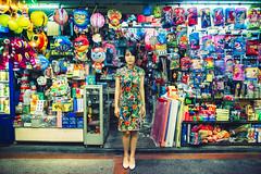 Patterns (Jon Siegel) Tags: nikon d810 sigma 24mm 14 sigma24mmf14art 24mm14 woman girl beauty beautiful cheongsam shop shopping night evening chinatown chinese singapore singaporean people colorful camo camouflage linying musician