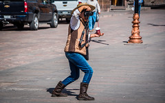2016 - Mexico - San Luis Potosi - Aim, Drink, Smoke (Ted's photos - Returns late December) Tags: 2016 cropped mexico nikon nikond750 nikonfx sanluispotosi tedmcgrath tedsphotos tedsphotosmexico vignetting photographer canon camer shadow streetscene street hat lens cameralens aiming straw nescafe cup cigarette smoker strawhat boots denim denimjeans female shooting framing composing teeth dents eos eosdigital people peopleandpaths