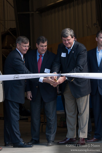 "Just before the cutting<br /><span style=""font-size:0.8em;"">ConnDOT Commissioner Jim Redeker, CT State Senator Gary LeBeau and RailAmerica SVP & COO Paul Lundberg prepare to cut the ribbon.</span> • <a style=""font-size:0.8em;"" href=""http://www.flickr.com/photos/20365595@N04/7050764093/"" target=""_blank"">View on Flickr</a>"