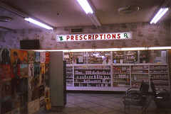 Huntridge Pharmacy (Nick Leonard) Tags: old city vegas wallpaper film analog 35mm vintage lights downtown fuji chairs lasvegas nevada nick vinyl scan retro pharmacy 35mmfilm signage fujifilm seating yashica rx meds 400asa prescriptions expiredfilm fujisuperia carlzeiss fujisuperiaxtra400 tessar colorfilm yashicat4 epson4490 sgin huntridge stillopen expired2006 nickleonard marylandparkway charlestonblvd huntridgepharmacy believeinfilm