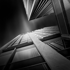 a path to the sky I - the tower (Julia-Anna Gospodarou) Tags: longexposure sky blackandwhite bw building tower monochrome architecture clouds square nikon perspective athens greece le tall streaks tamron highlight 2012 upwards manfrotto modernbuilding hoya curtainwall glasswall blacksky nd400 manfrotto055xprob athenstower bw106 nikond7000 juliaannagospodarou siruik20x tamronaf18270mm3563pzd