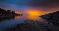 Norwegian archipelago (Explored) (Bangern) Tags: light sea sky panorama seascape color nature norway night clouds nikon illumination le citylights saturation archipelago d800 hurum 14mm samyang skjttelvik