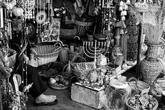 In wait (gyuri200) Tags: bw man shop snapshot leg vendor merchandise bazaar
