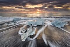 [ ... flying ice ] (D-P Photography) Tags: sun motion ice clouds sunrise canon island iceland waves iceberg longtimeexposure jökulsarlon leefilters breidamerkursandur canoneos5dmarkiii