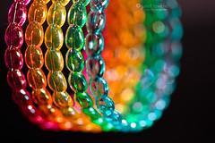5 Bracelets (j.towbin ©) Tags: macro rainbow bokeh 5 curves plastic bracelets coloful macromondays allrightsreserved©