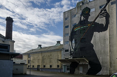 Grain silo with mural (AstridWestvang) Tags: industry mill rogaland silos streetart