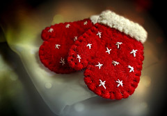 My Little Red Mittens. (Through Serena's Lens) Tags: mm macromondays stitch mittens embroidery blanketstitch doublecrossstitch felt wool red white bokeh handmade christmas ornaments stilllife
