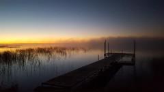 Foggy Am (mazzmn) Tags: dock water lake reflection clouds mist fog reeds fall autumn minnesota