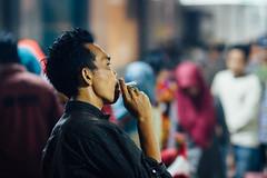 Smoking Cigarette at Night Market, Buleleng Indonesia (AdamCohn) Tags: adamcohn bali buleleng indonesia cigarette cigarettesmoke man market marketplace nightmarket smoking wwwadamcohncom
