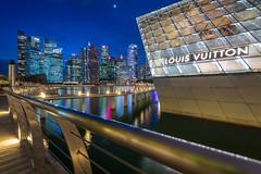 Louis Vuitton Singapore [Explored] (BP Chua) Tags: singapore lv louisvuitton shoppes mbs marinabay marinabaysingapore marinabaysands blue bluehour nikon d800e wideangle landscape longexposure buildings glass water river asia