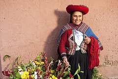 183773511 (charrison@impact-us.com) Tags: aymaraindian vibrantcolor developingcountries realpeople travel altiplano tourism onewomanonly women female peruvianethnicity facialexpression threequarterlength textileindustry urubambavalley souvenir craftproduct traditionalclothing pisac cuzco adult smiling standing weaving knitting working inca quechaindian ethnic indigenousculture ethnicity cap hat oneperson bazaar happiness multicolored woven wool textile traditionalculture traveldestinations outdoors horizontal closeup cheerful humanface people peru southamerica wall streetmarket market village travellocations travelbackgrounds industry manufacturing peruvianculture