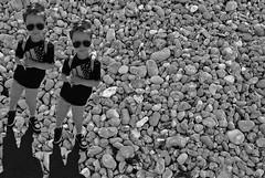 Clonage (Franois Tomasi) Tags: boy garon enfant blackandwhite galet galets plage pointdevue pointofview pov black white noir blanc nikon google yahoo flickr franois tomasi franoistomasi clairage light lights lumire lumires composition photoshop clonage double sombre dark automne wow