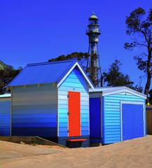 Bathing Boxes (jatakaphoto) Tags: lighthouse bathingboxes beach bayside portphillip foreshore seaside blues reddoor sand blue skies