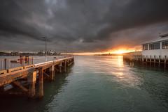 Shock and Awe (duncan_mclean) Tags: ferrybuilding sun devonport victoriawharf sunset landscape cbd wharf sea city lastlight horizon evening auckland dusk