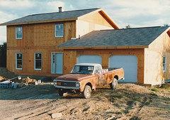 SYLVIA AND CHIPS NEW HOUSE IN 1987 (richie 59) Tags: ulstercountyny ulstercounty newyorkstate newyork unitedstates generalmotors chevrolet townofnewpaltzny townofnewpaltz nystate richie59 america outside chevytruck summer constructionarea constructionsite chevypickuptruck chevy4x4 construction newconstruction oldphotograph olddays oldpicture oldphoto film photoscan 1980s 1987 35mmfilm 35mm filmcamera filmphotography july291987 july1987 newhouse gmtruck gm hudsonvalley midhudsonvalley midhudson nys ny usa us house woodenhouse newwoodenhouse dirt trees oldchevytruck oldtruck oldpickuptruck pickuptruck chevy pickup rustypikuptruck rustytruck rustychevytruck rustychevy frontend headlights grill orangetruck frontyard driveway 4x4 4wheldrive fourwheeldrive