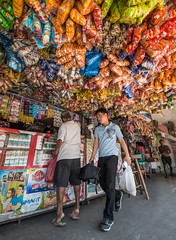 Passing under the snack cloud (FotoGrazio) Tags: asian composition color junkfood vendor pinoy photographicart internationalphotographer worldphotographer sidewalkvendor waynegrazio streetphotography internationalphotographers sarisari business lifeinthephilippines waynesgrazio streetscene pacificislanders people legazpi philippines californiaphotographer sandiegophotographer documentaryphotography colorful photographicartist photography snacks artofphotography conveniencestore filipino streetportrait fotograzio flickr digitalphotography 500px socialdocumentary