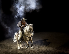 024693626-83-2016 NFR 6 Gun Cowboy-2 (Jim There's things half in shadow and in light) Tags: 2016 canon5dmarkiv canon70200lens nfr nationalfinals nevada rodeo southwest thomasandmack unlv action cowboy december sports pistol horse horsebackriding