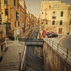 Valletta Street View (Allard One) Tags: streets cars architecture vintage island spring nikon republic citadel capital battery malta 11 retro crop april historical maltese lente ways eclectic automobiles harsh bold streetview telephonebooth archipelago 2012 valletta toning telefooncel capitalcity vierkant liesse hoofdstad singleraw nikcolorefexpro noiseadded d700 ilbelt nikond700 vergeeld nikkor2470mmf28 mediterraneancountry nikonfx allardone allard1 duohardstrak stbarbarabastion fullframepower allardschagercom