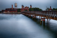 Ellis Island (SunnyDazzled) Tags: longexposure bridge sky newyork tower history water island evening bay jerseycity ellis stormy upper service immigration libertystatepark singleexposurewithhdreffect