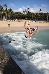jumping off the pier IMGP1204 (Guy: Jussum Guy) Tags: ocean people beach hawaii pier surf waikiki oahu flip honolulu walls kapahulugroin pentaxk30