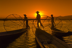 20060108_burma (signaturesofasia) Tags: sunset people lake men water boat fishing fisherman asia fishermen burma myanmar inlelake mm trap shanstate legrowing myanmarburma legrower shanplateau conicaltrap