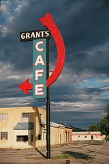Curvy Grants Cafe Sign on Route 66 in Grants, New Mexico on Film (eoscatchlight) Tags: newmexico film clouds analog cafe route66 kodak roadsideamerica olympusom2 om2 grants mainstreetusa kodakfilm cafesign zuiko50mmf14 themotherroad kodakektar kodakektar100