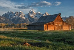 Celebrating 100 Years (dbushue) Tags: mountains nature clouds barn landscape nikon scenery icon historic wyoming grandtetonnationalpark coth gtnp mormonrow supershot 2013 antelopeflatsroad absolutelystunningscapes damniwishidtakenthat coth5 tamoultonbarn sunrays5