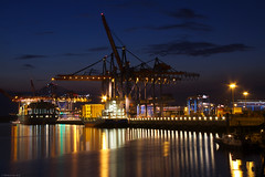 Burchardkai at night (Mr. Pebble / Bildwerfer) Tags: city longexposure light reflection water night port canon germany deutschland lights harbor wasser ship nightshot nacht harbour ships hamburg terminal container kai shipping hafen available spiegelungen burchardkai hhla containerumschlag containerbrucken