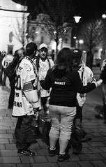 Praktica BC1 - Kometa Fans 2 (Kojotisko) Tags: street city people bw streets night vintage person nightshot czech streetphotography brno cc creativecommons vintagecamera czechrepublic streetphoto nightphoto fans persons praktica kodak400tx kometa prakticar prakticabc1 sportfans icehockeyfans kometabrno prakticar118f50mm