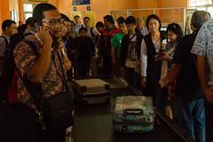 Waiting in Line (mikestewartinasia) Tags: southeastasia people airport malang eastjava indonesia java asia indoor